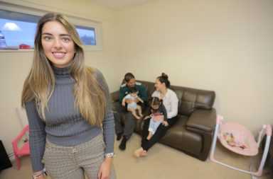 Yasmine Zweegers (long hair, grey high neck jumper). Miguel is the guy sitting on the sofa in the green jumper with baby Kaeli and then next to them is Mum Sheila Croft with baby Kiara on her lap.