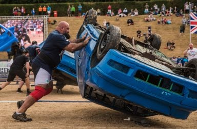 2017 UK's Strongest Man Laurence Shahlaei flips a car over in the Car Roll event.