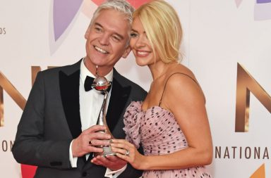 """LONDON, ENGLAND - JANUARY 22: Phillip Schofield (L) and Holly Willoughby, accepting the award for Best Daytime for """"This Morning"""" poses in the Winners Room during the National Television Awards held at The O2 Arena on January 22, 2019 in London, England. (Photo by David M. Benett/Dave Benett/Getty Images)"""