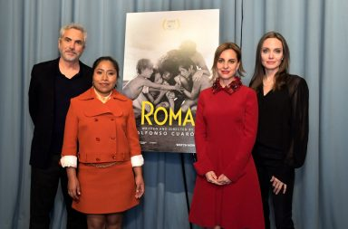 "WEST HOLLYWOOD, CALIFORNIA - JANUARY 05: Alfonso Cuarón, Yalitza Aparicio, Angelina Jolie and Marina De Tavira attend the ""ROMA"" Tastemakers Screening and Reception at San Vicente Bungalows on January 05, 2019 in West Hollywood, California. (Photo by Charley Gallay/Getty Images for Netflix)"